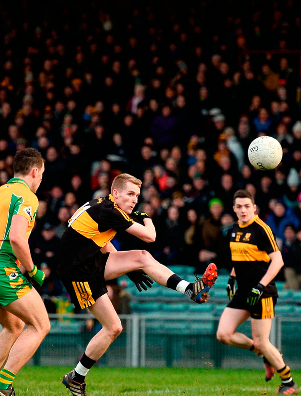 Gavin O'Shea of Dr Crokes shoots to score his side's first goal