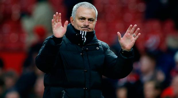 Manchester United manager Jose Mourinho acknowledges fans after the game