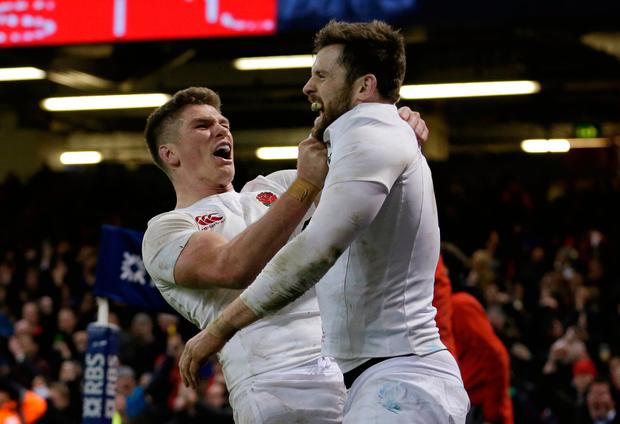 England's Elliot Daly celebrates scoring a try with Owen Farrell