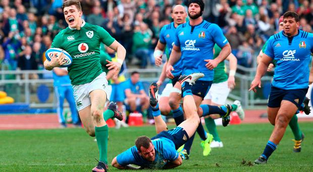 Garry Ringrose races away from the Italian defence to score one of Ireland's tries yesterday. Photo: Ramsey Cardy