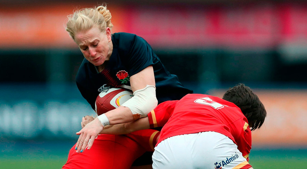 England's Tamara Taylor attempts to break through the Wales defence during the RBS Women's 6 Nations at the Cardiff Arms Park. England won 63-0. Photo: David Davies/PA