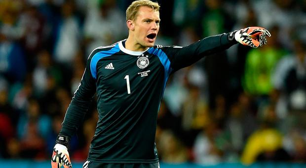 Bayern Munich's Manuel Neuer, seen above in action for the national team, believes his club are not quite ready to be 'dominant' just yet Photo: Getty Images