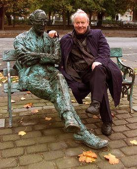 WITH THE GREATS: Brendan Kennelly at the Paddy Kavanagh statue on the Grand Canal in 2004. Photo: Martin Nolan