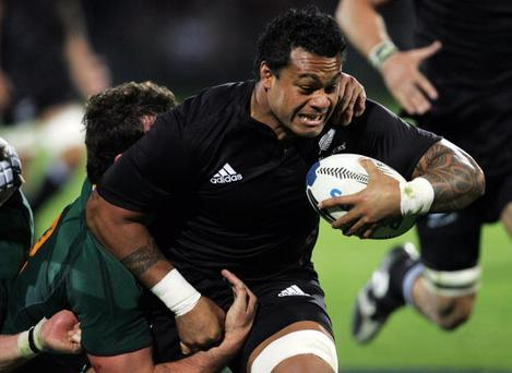 DUNEDIN, NEW ZEALAND - JULY 12: Sione Lauaki of the All Blacks breaks a tackle on the way to scoring a try during the 2008 Tri Nations series match between the New Zealand All Blacks and the South African Springboks at Carisbrook on July 12, 2008 in Dunedin, New Zealand. (Photo by Sandra Mu/Getty Images)