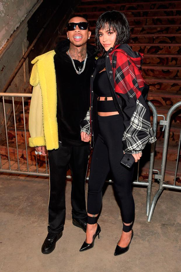Tyga (L) and Kylie Jenner attend the Alexander Wang February 2017 fashion show during New York Fashion Week on February 11, 2017 in New York City. (Photo by Jason Kempin/Getty Images)