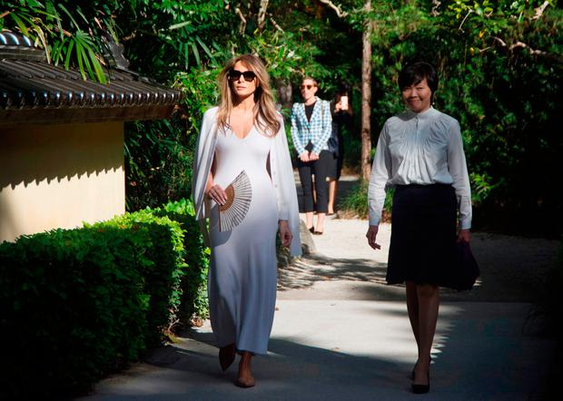 US First Lady Melania Trump (L) and Akie Abe, wife of Japanese Prime Minister Shinzo Abe, tour Morikami Museum and Japanese Gardens in Delray Beach, Florida