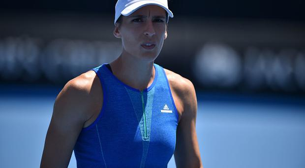 Germany's Andrea Petkovic was not happy with the anthem mistake. / AFP / PETER PARKS