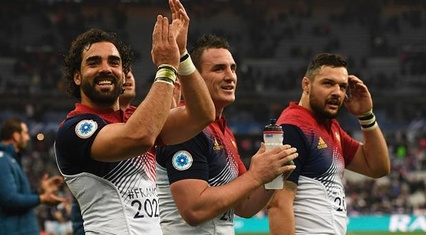 (From L) France's wing Yoann Huget, France's flanker Louis Picamoles and France's Number Eight Damien Chouly greet the crowd after winning the Six Nations international rugby union match between France and Scotland at the Stade de France in Saint-Denis, on February 12, 2017. / AFP / CHRISTOPHE SIMON