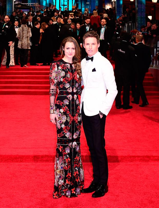 Eddie Redmayne and Hannah Bagshawe attending the EE British Academy Film Awards held at the Royal Albert Hall, Kensington Gore, Kensington, London. See PA Story SHOWBIZ Bafta. Photo: Ian West/PA Wire