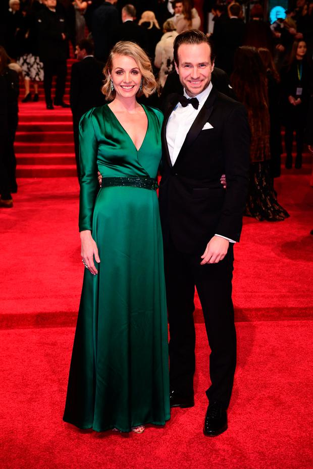 Rafe Spall and Elize du Toit attending the EE British Academy Film Awards held at the Royal Albert Hall, Kensington Gore, Kensington, London. PRESS ASSOCIATION Photo. Picture date: Sunday 12 February 2017.