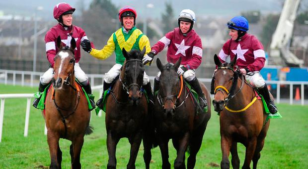 Robert Power is congratulated by some his his fellow jcckeys after partnering Sizing John to victory at Leopardstown. Photo credit: PA Wire