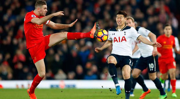Determination is the game for Jordan Henderson as he gets the better of Son Heung-min. Photo: Reuters / Carl Recine