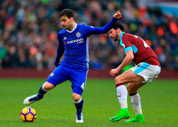 Burnley's George Boyd (right) and Chelsea's Cesc Fabregas battle for the ball. Photo credit: Nigel French/PA Wire