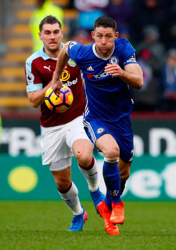 Chelsea's Gary Cahill in action with Burnley's Sam Vokes. Photo: Reuters / Jason Cairnduff