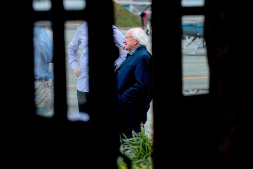 President Higgins at the Military air base as he waited for cloud cover to clear
