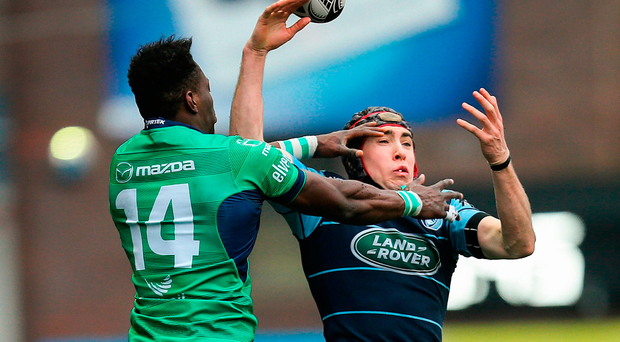 Connacht's Niyi Adeolokun competes with Rhun Williams of Cardiff Blues for control of the ball Photo: Gareth Everett/Sportsfile