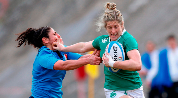 Ireland's Alison Miller hands off Italy's Lucia Cammarano during yesterday's Women's Six Nations match in L'Aquila, Italy Photo: Roberto Bregani/Sportsfile