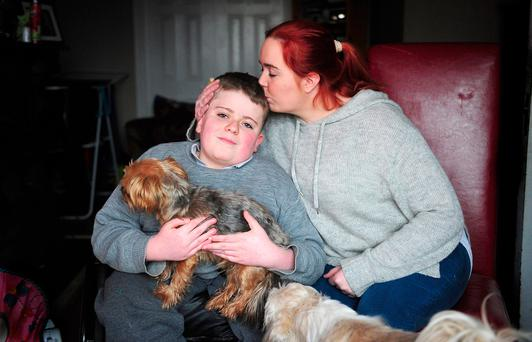 Amanda Coughlan and her son TJ (12), holding his dog Cookie, at their home in Tullamore, Co Offaly. Photo: James Flynn/APX