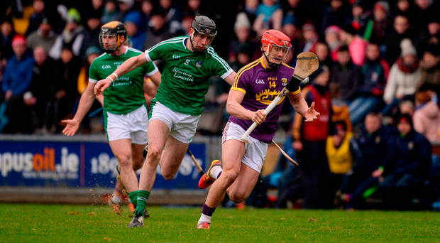 Wexford's Lee Chin gives Limerick's Diarmaid Byrnes the slip. Photo by Daire Brennan/Sportsfile