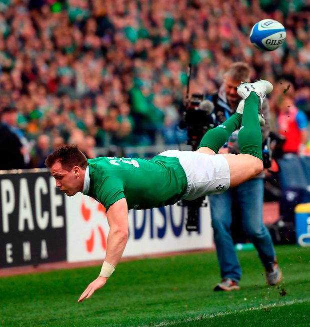 Craig Gilroy acrobatically attempts to keep the ball in play Photo: Stephen McCarthy/Sportsfile
