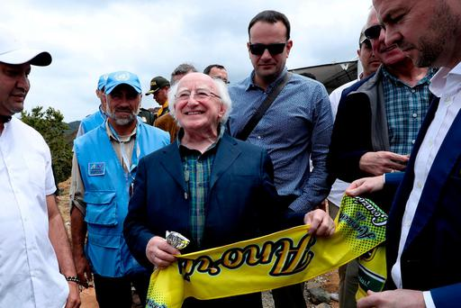 President Michael D Higgins is presented with a scarf from the Anori municipality as Social Protection Minister Leo Varadkar looks on. Photo: Maxwells