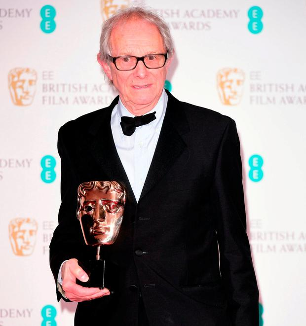 Ken Loach with the award for Outstanding British Film. Photo: Ian West/PA Wire