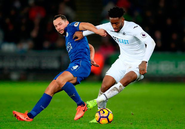 Leicester City's Daniel Drinkwater (left) and Swansea City's Kyle Naughton battle for the ball. Photo credit: Nick Potts/PA Wire