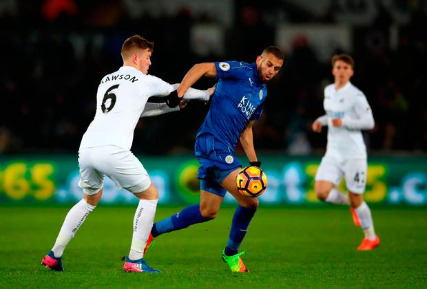 Swansea City's Alfie Mawson (left) and Leicester City's Islam Slimani in action. Photo credit: Nick Potts/PA Wire