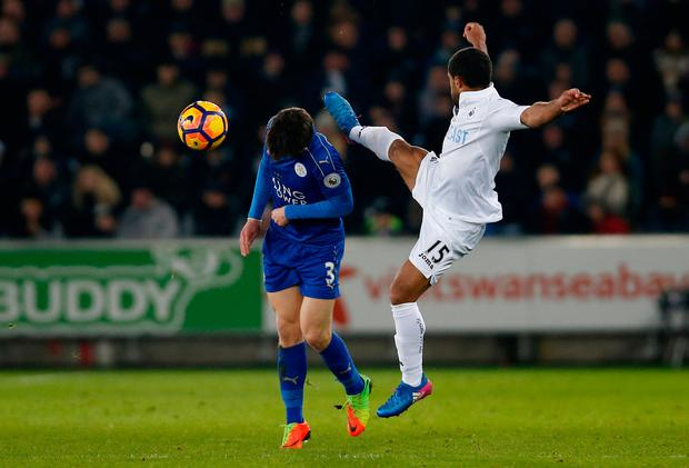 Swansea City's Wayne Routledge in action with Leicester City's Ben Chilwell. Photo credit: Reuters / Paul Childs