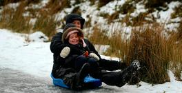 Ben and Kate Marchant, Rathfarnham, Dublin, make the most of the cold snap in the Wicklow gap. Photo: Garry O'Neill