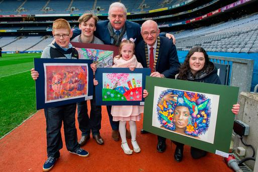 Credit Union art competion prizewinners (l-r) Darragh Hunter-Kerr (10), Letterkenny, Co Donegal; Eoin Herlihy (15), Rathmore, Co Kerry; Marty Whelan; Margaux Gilbourne (7), Millstreet, Co Cork; Brian McCrory, ILCU president; and Hannah Wright (17), Rathmore, Co Kerry. Photo: Douglas O'Connor