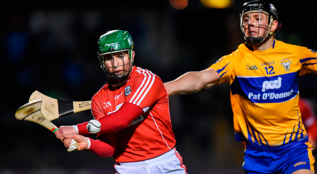 Clare's Cathal Malone tries to hook Cork's Daniel Kearney. Photo by Matt Browne/Sportsfile