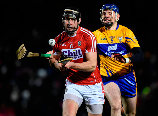 Mark Ellis of Cork in action against David Fitzgerald of Clare. Photo by Matt Browne/Sportsfile