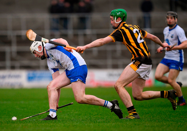 Shane Barrett of Waterford in action against Joey Holden of Kilkenny. Photo by Ray McManus/Sportsfile