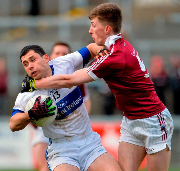 Ruairi Trainor of St Vincent's in action against Paul McNeill of Slaughtneil. Photo: Oliver McVeigh/Sportsfile