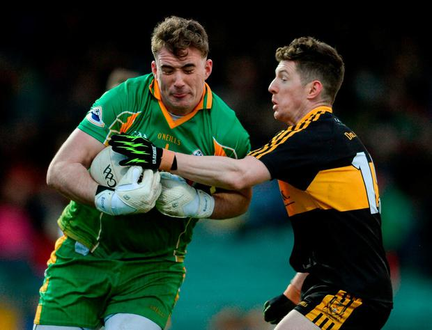 Corofin's Brendan Power in action against Dr Crokes' Kieran O'Leary. Photo: Eóin Noonan/Sportsfile