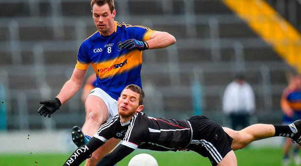 Tipperary's Alan Moloney under pressure from Sligo's Adrian McIntyre at Semple Stadium. Photo: Seb Daly/Sportsfile