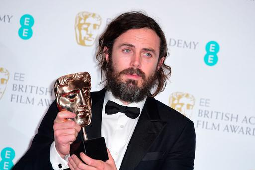 Casey Affleck with the award for Leading Actor for the film Manchester By The Sea in the press room during the EE British Academy Film Awards held at the Royal Albert Hall, Kensington Gore, Kensington, London. PRESS ASSOCIATION Photo. Picture date: Sunday 12 February 2017. See PA Story SHOWBIZ Baftas. Photo credit should read: Ian West/PA Wire