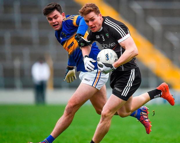 Sligo's Kevin McDonnell in action against Tipperary's Michael Quinlivan. Photo: Seb Daly/Sportsfile