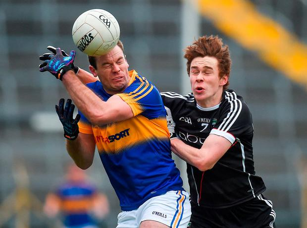 Tipperary's Alan Maloney in action against Sligo's Gerard O'Kelly-Lynch. Photo: Seb Daly/Sportsfile