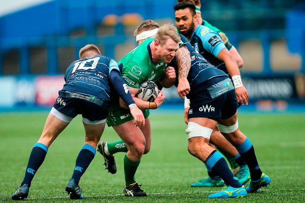Connacht's Tom McCartney breaks the tackle of Gareth Anscombei of Cardiff Blues Photo: Gareth Everett/Sportsfile