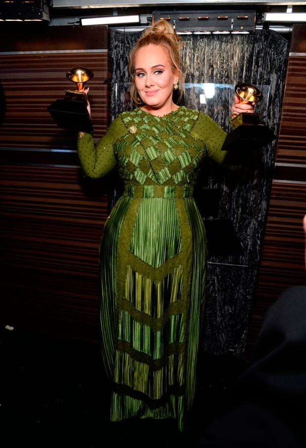 Recording artist Adele, winner of the Song Of The Year and Record Of The Year awards for 'Hello,' and Album Of The Year award for '25,' poses backstage during the The 59th GRAMMY Awards at STAPLES Center on February 12, 2017 in Los Angeles, California. (Photo by Michael Kovac/Getty Images for NARAS)