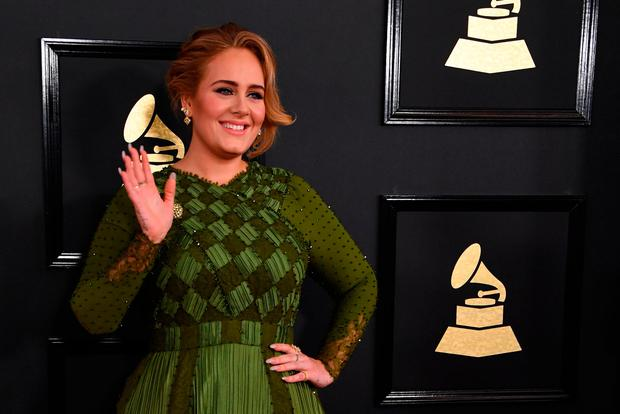 Adele arrives for the 59th Grammy Awards pre-telecast on February 12, 2017, in Los Angeles, California. / AFP PHOTO / Mark RALSTONMARK RALSTON/AFP/Getty Images