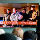 People watch a TV news program showing a photo published in North Korea's Rodong Sinmun newspaper of North Korean leader Kim Jong Un, at Seoul Railway station in Seoul, South Korea, Monday, Feb. 13, 2017.(AP Photo/Ahn Young-joon)