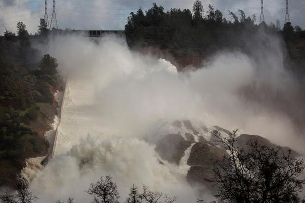 65,000 cfs of water flow through a damaged spillway on the Oroville Dam in Oroville, California, U.S., February 10, 2017. REUTERS/Max Whittaker