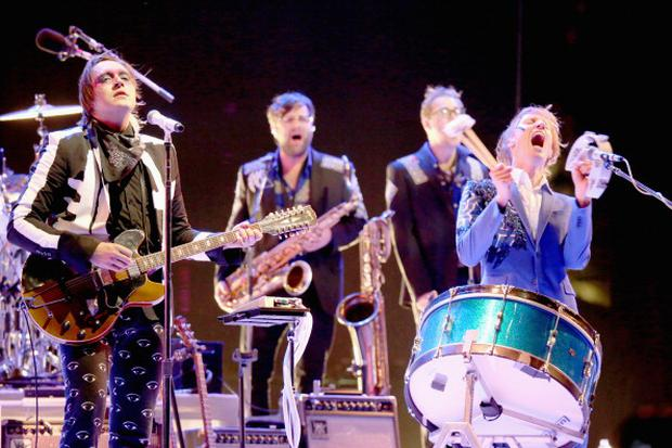 (L-R) Musicians Win Butler and Richard Parry of Arcade Fire perform onstage during day 3 of the 2014 Coachella Valley Music & Arts Festival at the Empire Polo Club on April 13, 2014 in Indio, California. (Photo by Karl Walter/Getty Images for Coachella)