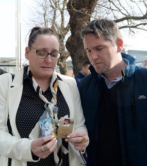 13 Feb 2017; Parents of late Lorcan O'Reilly; father Paddy Rooney and mother Jenny O'Reilly hold photos of their son outside the CCJ. Parkgate Street, Dublin. Picture: Caroline Quinn