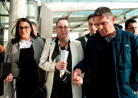 Parents of the late Lorcan O'Reilly, Paddy Rooney, right, and Jenny O'Reilly, centre, leaving court after speaking to the media. Photo: Caroline Quinn