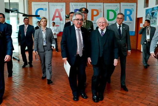 President Michael D Higgins at the Universidad National de Colombia (UNAL) as he makes his way to give his address on the Irish and Colombian peace processes with Professor Ignacio Mantilla Prada, left, rector of UNAL. Photo: Maxwells