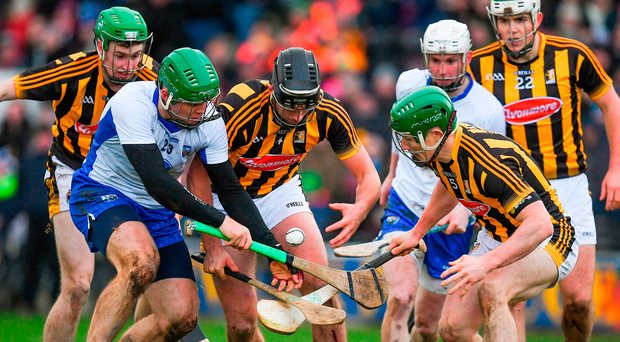Tom Devine of Waterford battles for possession with Kilkenny's Conor O'Shea (centre) and Paul Murphy in Nowlan Park Picture: Sportsfile